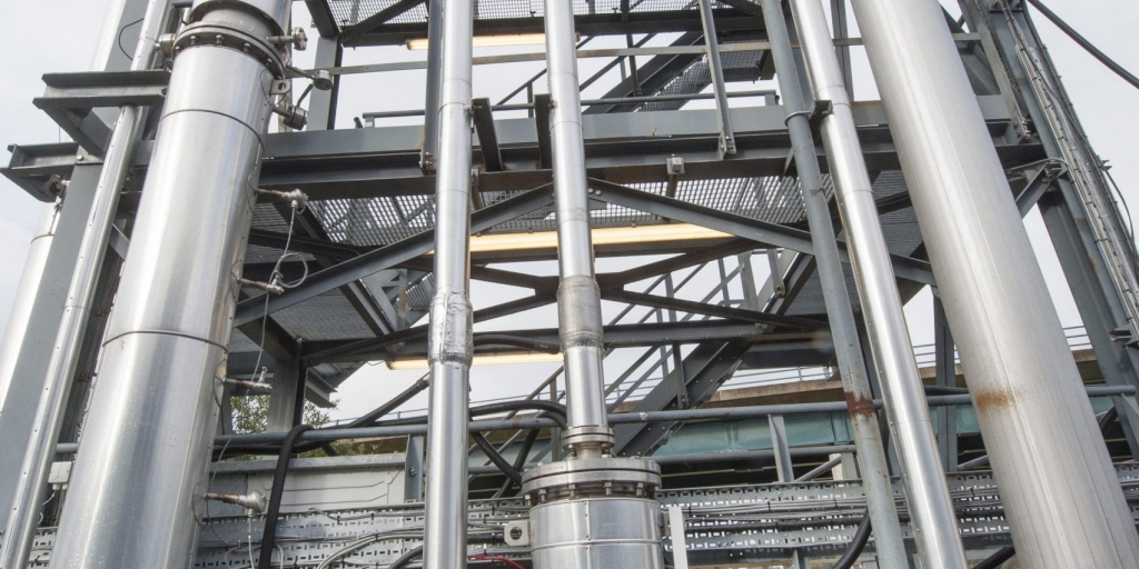 a picture of the tall, metallic pipes of the amine capture plant